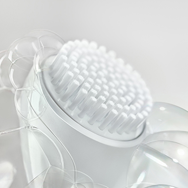 White background with bubbles surrounding white brush