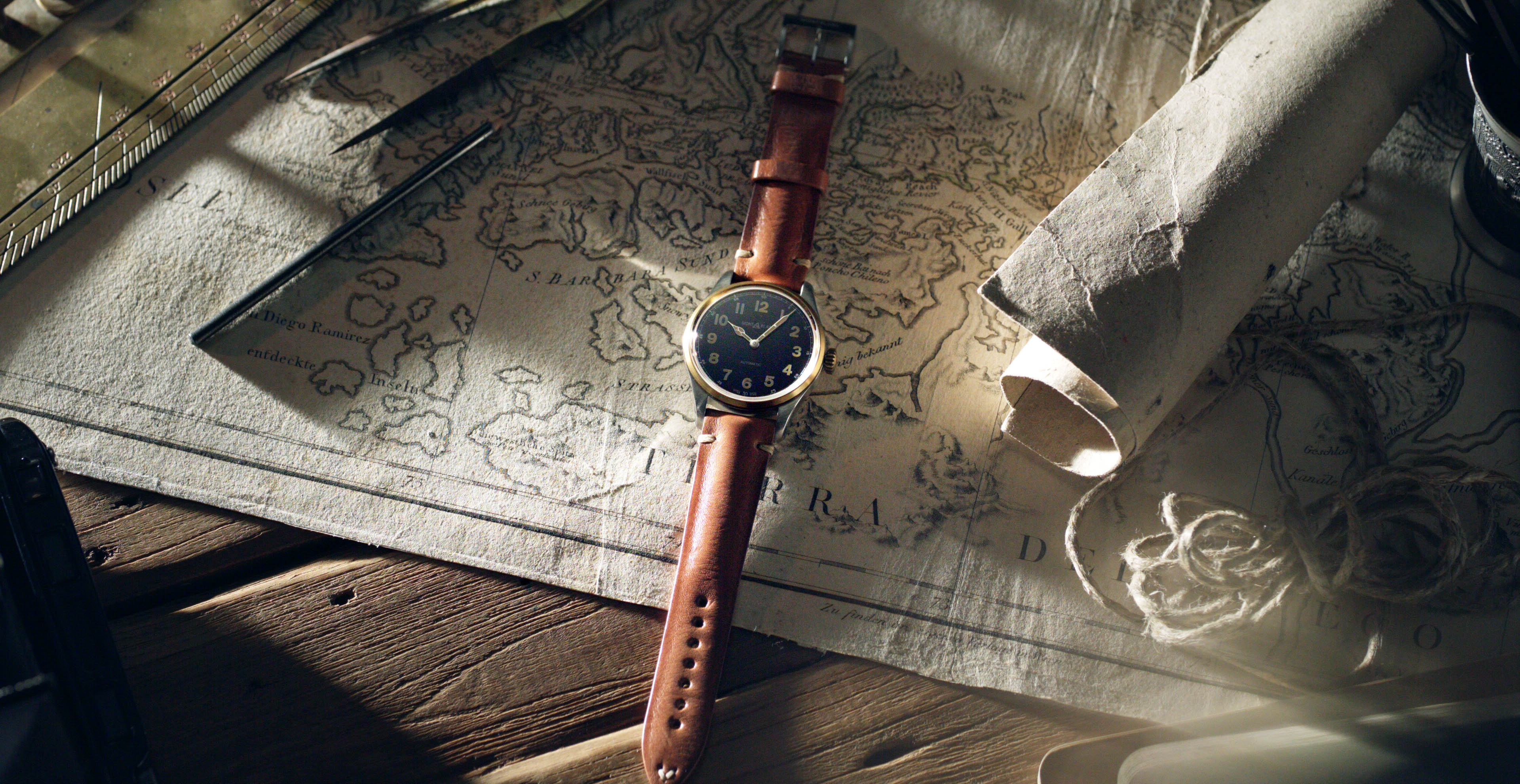 Brown watch on an old map