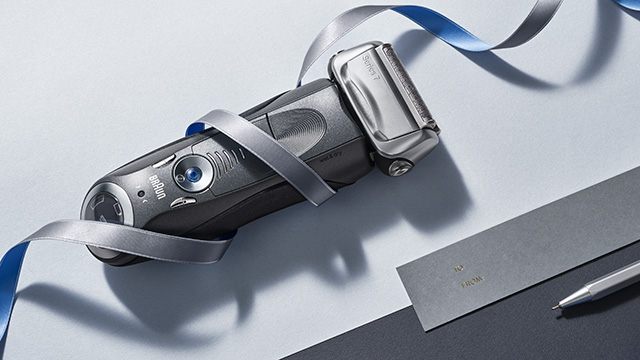 Silver shaver with blue & silver ribbon wrapped around it