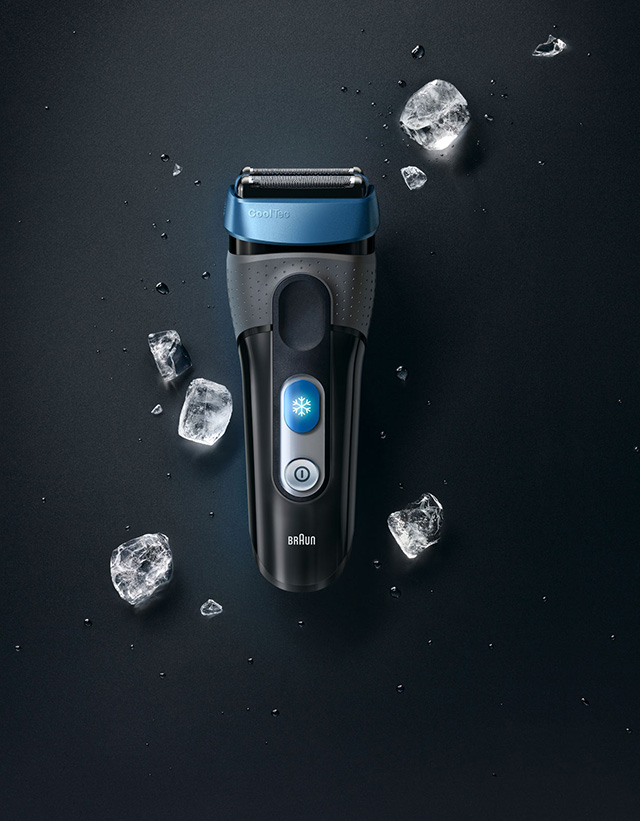 Black background with grey shaver and ice cubs around it