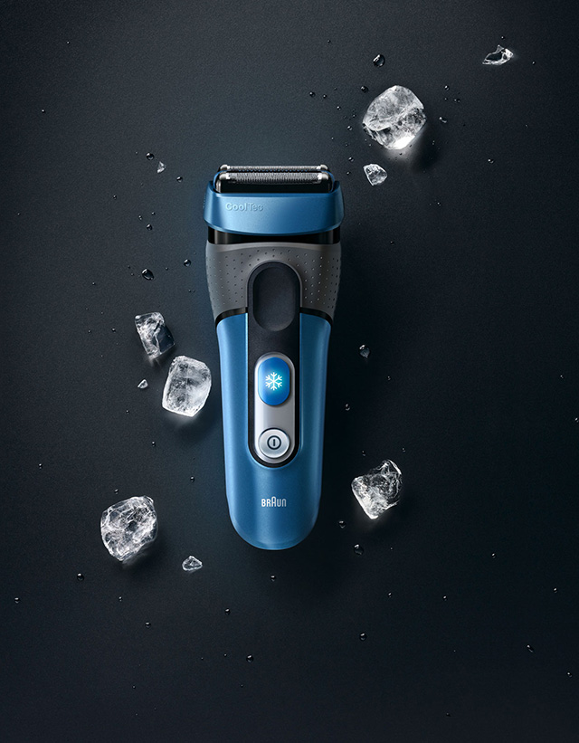 Black background with blue shaver and ice cubs around it