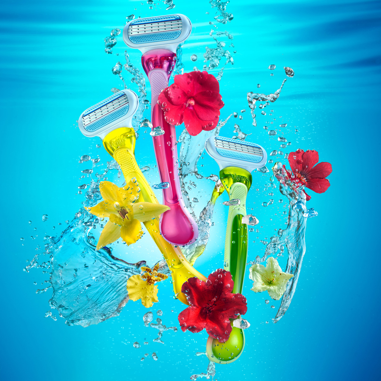 3 shaver with flowers floating under water